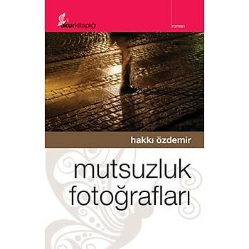 Mutsuzluk Fotoðraflarý - Hakký Özdemir - Okur Kitaplýðý